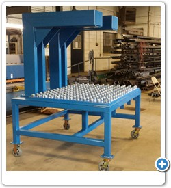 Custom designed frame and material table for a specialized press.