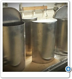 Stainless steel trash receptacles.